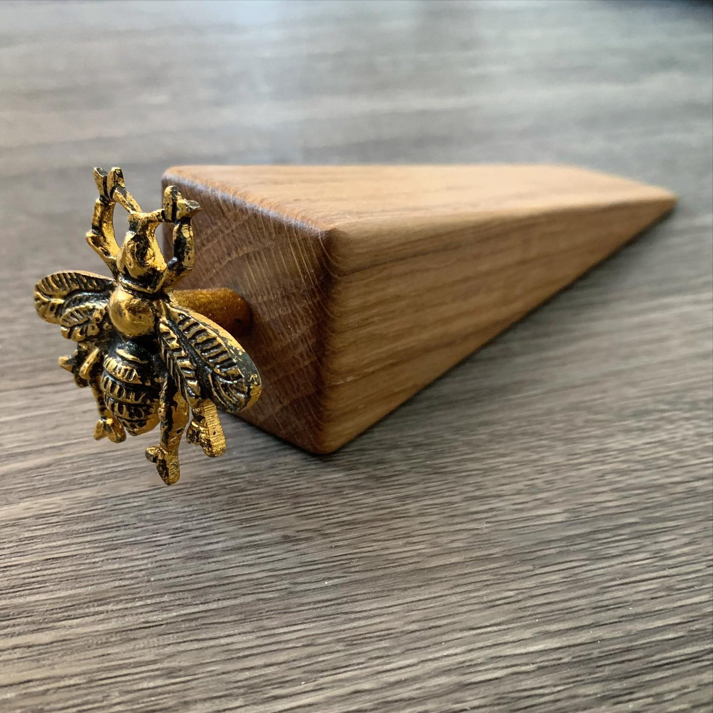 Now available online!  Bzzzzzz  ...#beehappy #bees #doorwedge #gold #oak #handcrafted #homewares #gingerandtweed #shopindependent #shophandmade