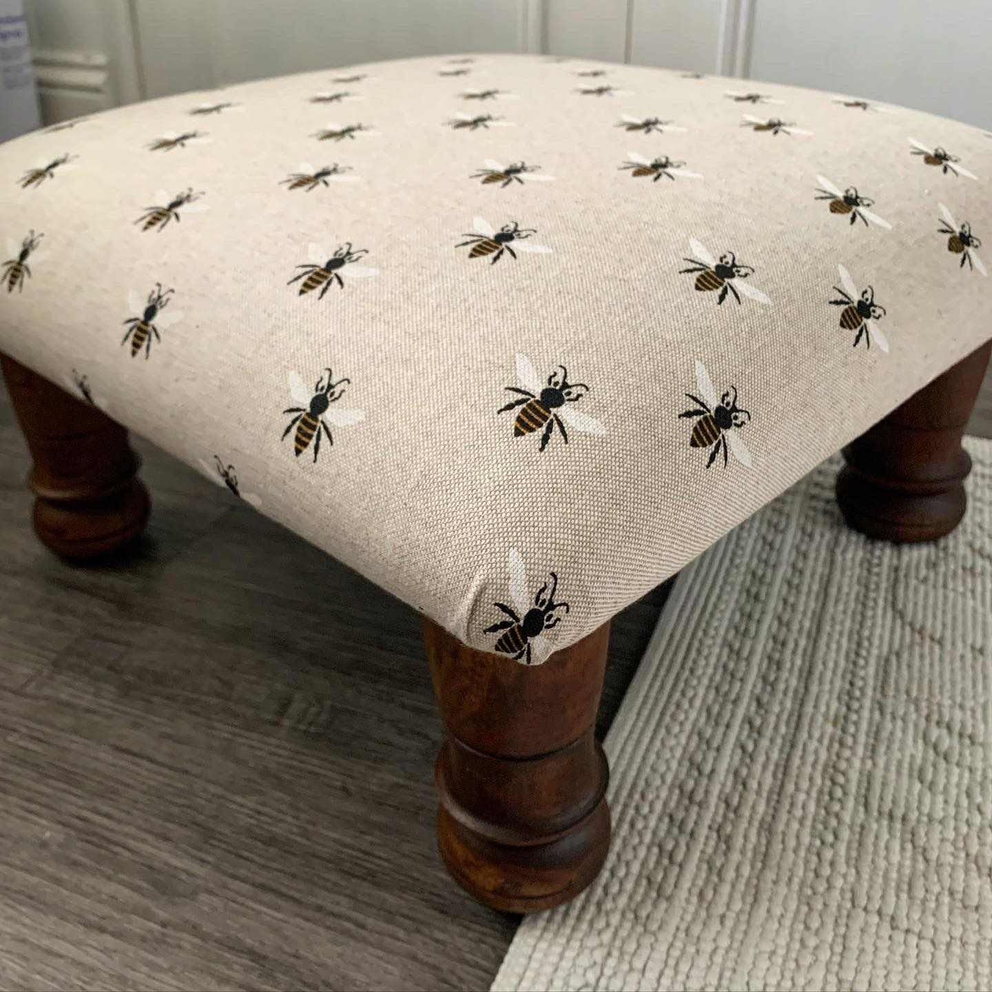 It's so satisfying to take a well loved stool that has seen better days and transform it into something fresh and new. This little stool has just been finished, and what a transformation! Swipe for before pic. ....#handcrafted #footstool #recover #reupholstery #bees #newlife #goodasnew #repurpose #homedecor #gingerandtweed #virtualcraftandflea