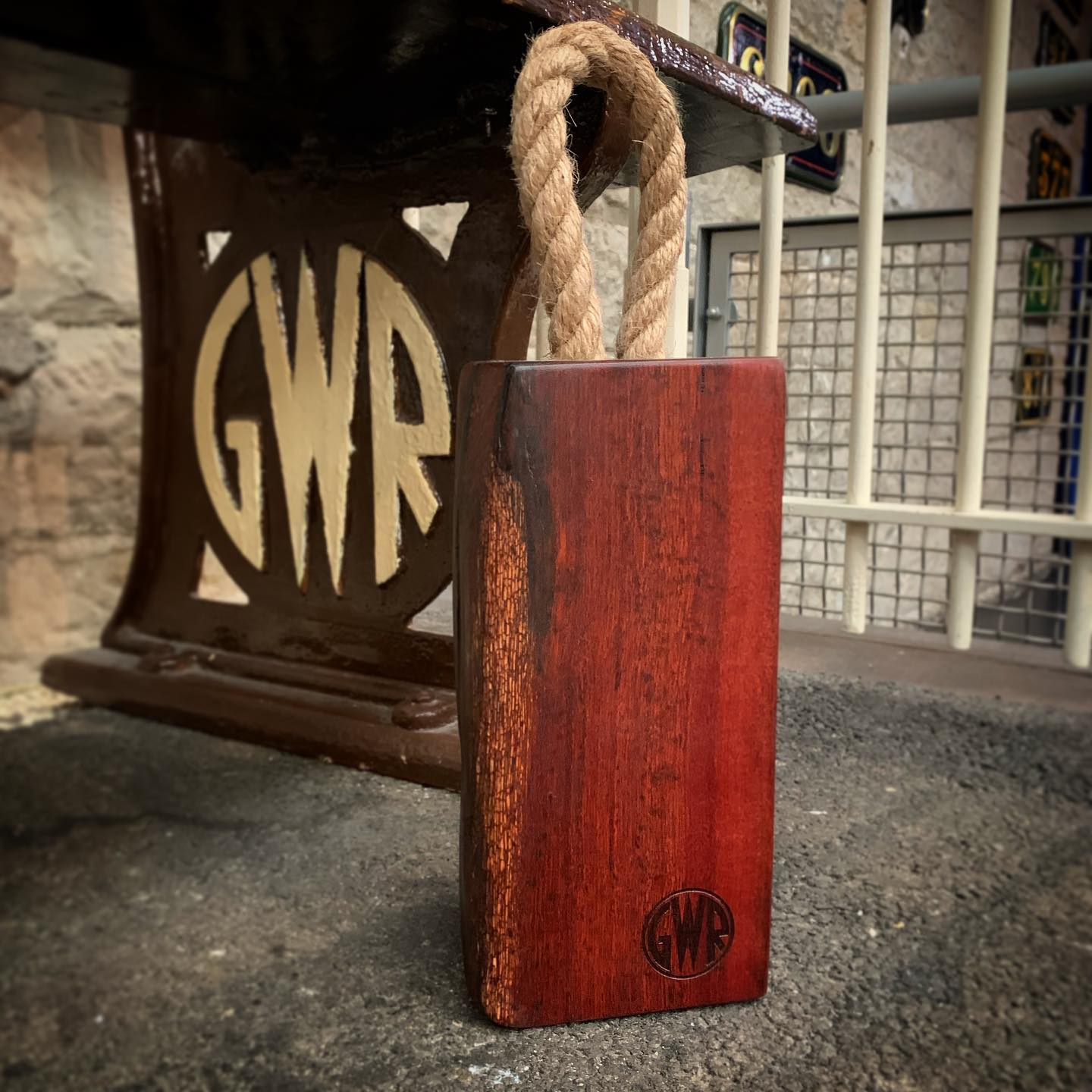 A limited number of these Jarrah GWR branded doorstops are now available at the @steammuseum Swindon.They are beautifully characterful, with holes and marks reminiscent of their former life beneath machinery for the Great Western Railway.We can't get over the colour! Really special and a pleasure to produce. ...#handcrafted #history #railway #gwr #steammuseum #preservation #restoration