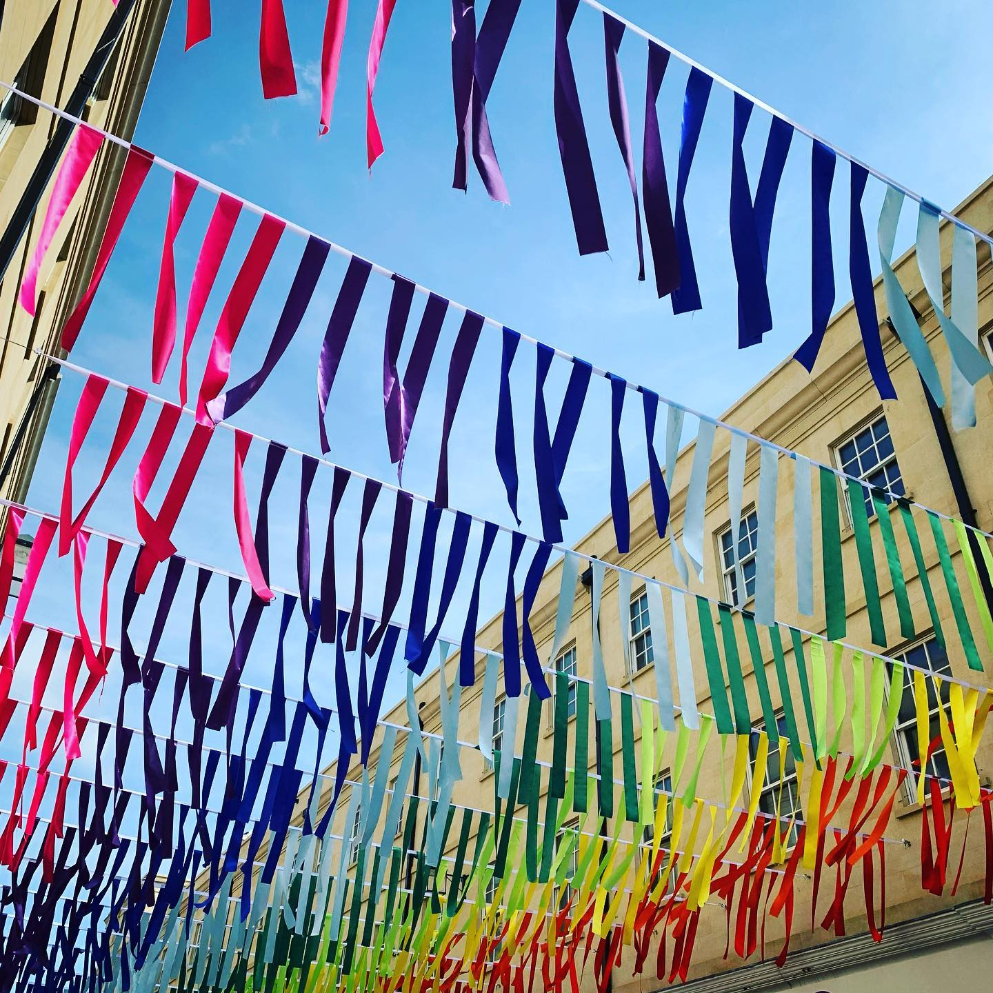 Cheerful colour at Baths Southgate  love how the tassels move constantly in the wind. ..#bath #bathbid #towncentre #home #rainbow #colour #cheer #somerset