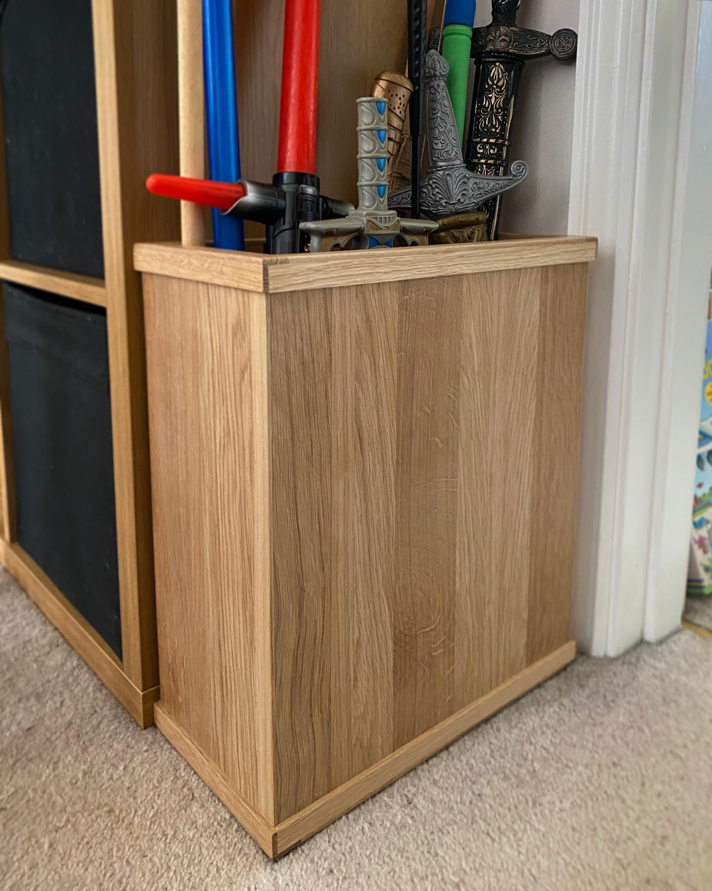 Here's a lovely project we recently worked on for a family member ️This oak storage box was designed to be in keeping with the surrounding decor, give our nephew easy access to his toys and keep this corner nice and tidy. So lovely to see it in use! What a great collection of swords and lightsabers!